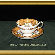 Hammersley Bone China Cup and Saucer in Apricot with Gold trim and medallions filled with ...