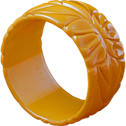 Wide butterscotch Bakelite carved floral bangle circa 1940