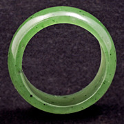 Spinach green jade band ring with few inclusions