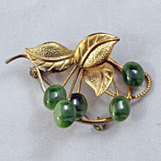 Vintage brooch pin with gilt leaves and green jade cherries