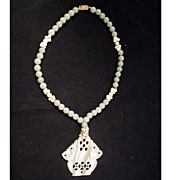 Chinese pale green jade, cultured pearl, coral and carved mother of pearl necklace