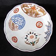 Colorful 19th Century Shallow Porcelain Japanese Imari Bowl with Buddhist Symbols
