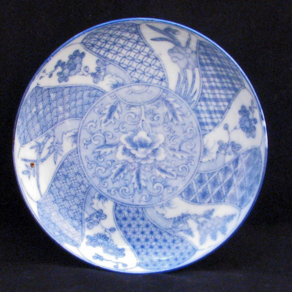 Japanese porcelain shallow bowl with pale blue stencil design c 1900