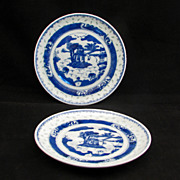 Pair of Canton Chinese export porcelain saucers 18th/19th century with a lake scene