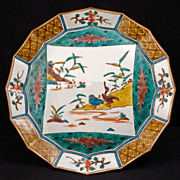 Japanese porcelain Meiji era (1868-1912) faceted ao-kutani plate with central scene of waterfo
