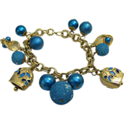 Gold and Blue Bracelet with enameled cow bells