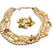 Vintage 5 strand Necklace with earrings in a peachy Orange color
