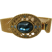 Vintage 1928 Jewelry company Bracelet Gold tone with blue stone