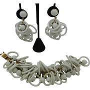Napier Bracelet and Earring set with white plastic rings and melon balls