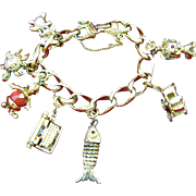 Monet Gold Tone Jeweled Mechanical Charm Bracelet