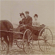 SOLD Cabinet Card- Two Ladies  Dressed For Visit Sitting In Buggy As Young Man Holds Horse's R