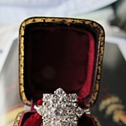 SOLD A diamond ring designed as a cluster, set in a 14 k white gold mount