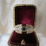 SOLD A Diamond and Emerald ring set in fourteen karat yellow and white gold