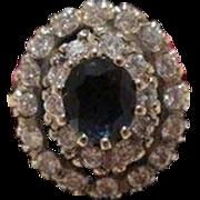 SOLD Sapphire and Diamond ring set in fourteen karat white gold
