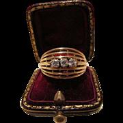 Diamond ring with open work fourteen karat yellow gold mounting