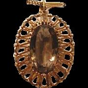 A Fourteen karat and Smokey Quartz pendant