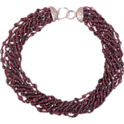 SOLD Sterling silver and eleven strand Garnet necklace, ca. 1900