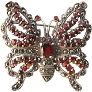 Garnet and Marcasite brooch in the shape of a butterfly, dated at about 1920