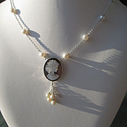Sterling Silver/ Freshwater Pearl and Carved Mother of Pearl Pendant of Young Lady