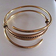 SOLD Mid Century Gold Plated Swirling Bangle Bracelet Made in England Signed
