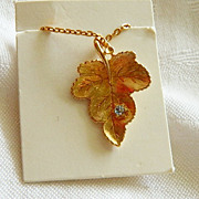 Classy Sleek Avon's Best Gold Plated Grape Leaf w Accent Stone Pendant