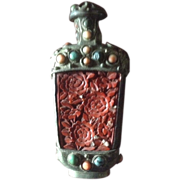19 th Century Chinese snuff bottle, carved cinnabar and set with coral ant turquoise stones.