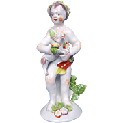 An English Bow Porcelain Figure Of A Putti Holding A Lamb, c.1760