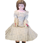 Somber Antique Solid Dome Paper Mache Head Doll in Beautiful Dress