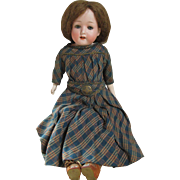 Antique Bisque Head Doll with Innocent Look