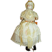 Small blond china head doll house doll