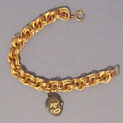Vintage Black Face Charm on Gold Tone Heavy Link Bracelet