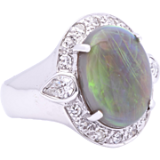 Ladies Australian 3.86 Carat Opal 18K White Gold Ring surrounded by Diamonds