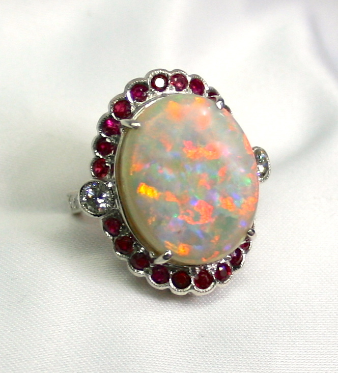 australian solid opal 18k white gold ring surrounded with