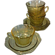 Four Amber Depression glass cup ans saucers