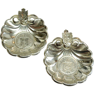 Outstanding  pair of 950 Sterling 1864 &1865 Footed Coin Ash trays with Coat of Arms Tobacciana