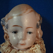 "5"" All Bisque German Jointed Doll with Blue Bows"