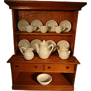 Step Back Cupboard with a White Porcelain Miniature Tea Set