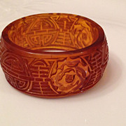Vintage Amber Colored Carved Resin Bangle
