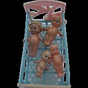 Thomas Toy Cradle 1940's Plastic w/4 miniature Celluloid Kewpies