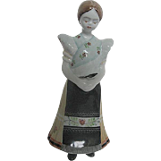 Vintage Hollohaza 1854 Ceramic Hand Painted figurine of a Young Lady wearing a Traditional Flo