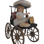 Old fashion Stroller w/large Spoke Wheels w/Bisque little Girl and Teddy Stationary figurine