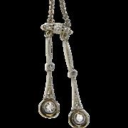 Edwardian double drop diamond pendant
