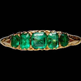 Emerald five stone carved half hoop ring