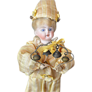 Bisque head doll, rattle type with bells