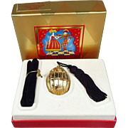 SALE PENDING Estee Lauder Knowing Solid Perfume Gold Egg with Tassel Compact