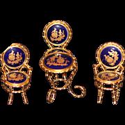 LIMOGES FOUR PIECE COBALT & GOLD TABLE & CHAIRS SET