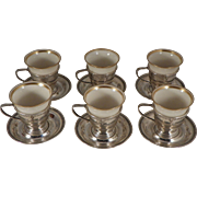 Six Demitasse Cups and Saucers.  Sterling and Porcelain.