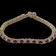 SALE Lovely Sterling Silver Vermiel Faux Diamond and Ruby 6 3/4 inch Tennis Bracelet