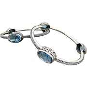 Artisan Handmade Bangle Bracelet in Sterling Silver and Blue Topaz