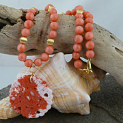 Handmade Coral and Brushed Gold Necklace with a Carved Coral Pendant